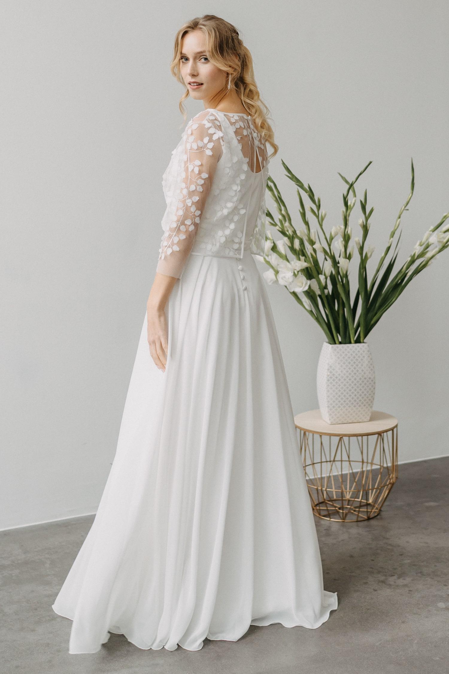Langes Hochzeitskleid mit austauschbarem Rock – gesehen bei frauimmer-herrewig.de
