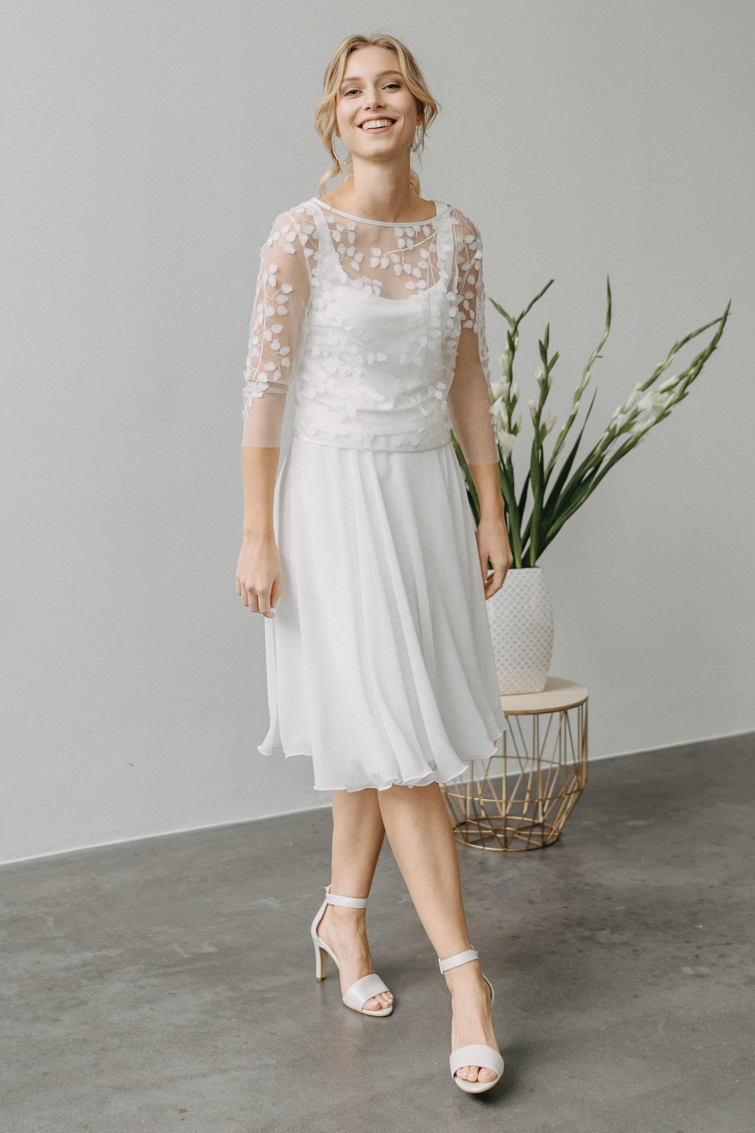 kurzes Hochzeitskleid mit austauschbarem Rock – gesehen bei frauimmer-herrewig.de